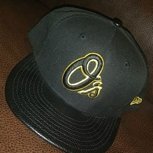 Black and gold w/leather bill orioles hat new era